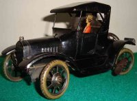 Bing Tin-Oldtimer Ford model T with lithographed lady...