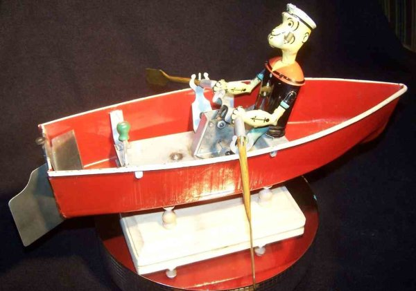 Hoge Mfg Co. Tin-Figures Popey the Sailor in rowboat with windup mechanism which  is