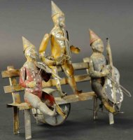 Guenthermann Tin-Clowns Three musician clowns seated on...