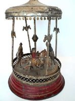 Guenthermann Tin-Carousels Carousel wind-up toy, this is...