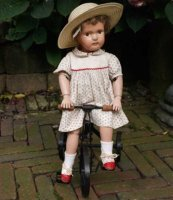 Schoenhut Dolls Doll Miss Dolly. The mohair wig is a...