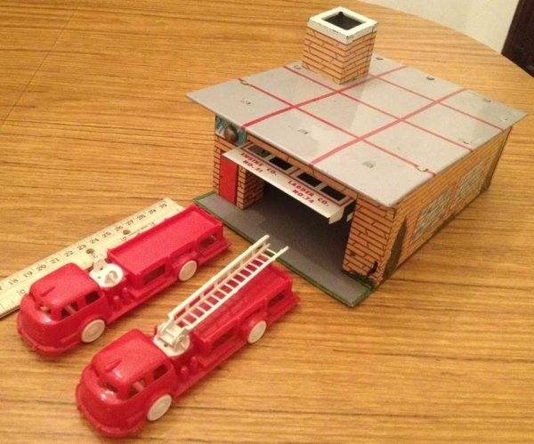 Wyandotte Tin-Buildings Fire station set with 2 plastic trucks. This set is complete