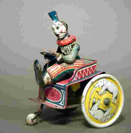 Greppert & Kelch Tin-Clowns Clown on tricycle with clockwork, wound up he drives by turn