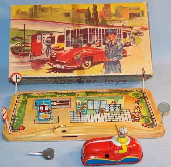 Hammerer & Kühlwein Tin-Toys Table game with clockwork in red, blue, yellow, beige, small