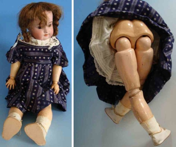 Simon & Halbig Dolls Porcelain head doll with sleep eyes and wooden body
