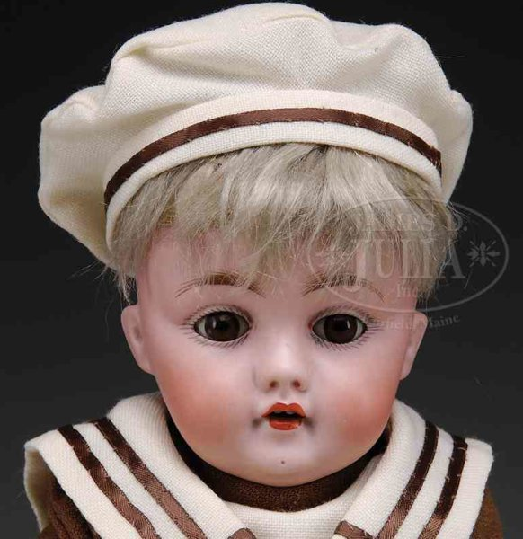 Kestner J. D. Dolls Boy doll with his original blond mohair wig and has brown gl
