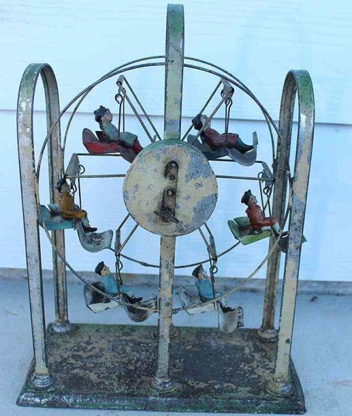 Guenthermann Tin-Carousels Ferris wheel tin clockwork wind-up toy, wound up it sins and