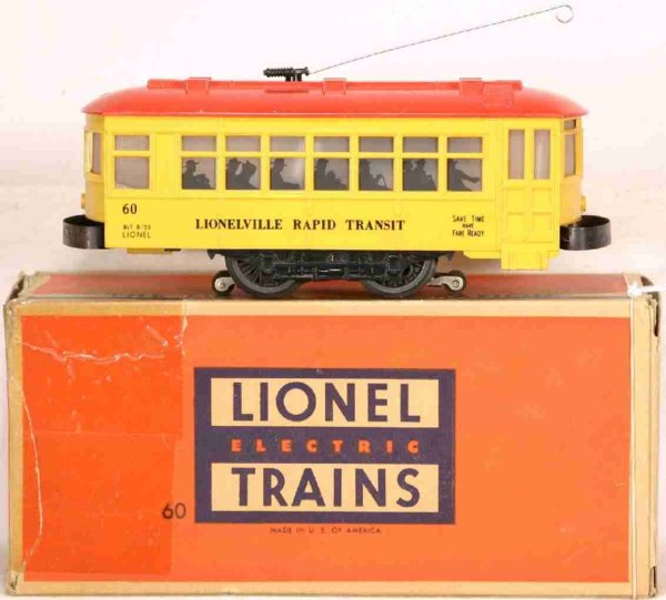 Lionel Tin-Trams Trolley yellow body and red roof, black lettered LIONVILLE