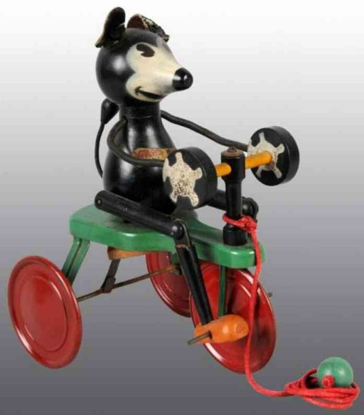 Chein Co. Tin-Figures Squeaky Ignatz, cycle rider, the tricycle is metal and the m