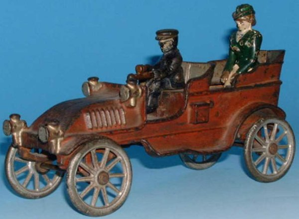 Dent Hardware Co Cast-Iron Oldtimer Touring Car with driver and lady