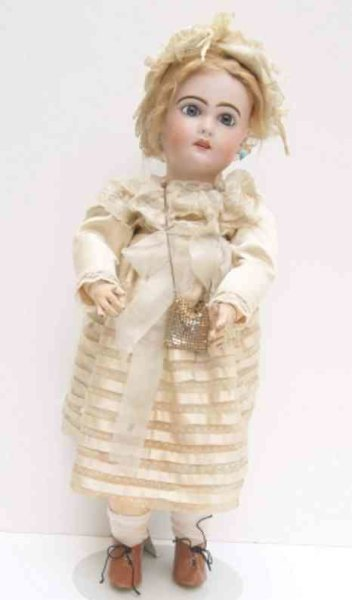 Jumeau Dolls Porcelain head doll, red stamp  lettering CIE JUMEAU Tete 6