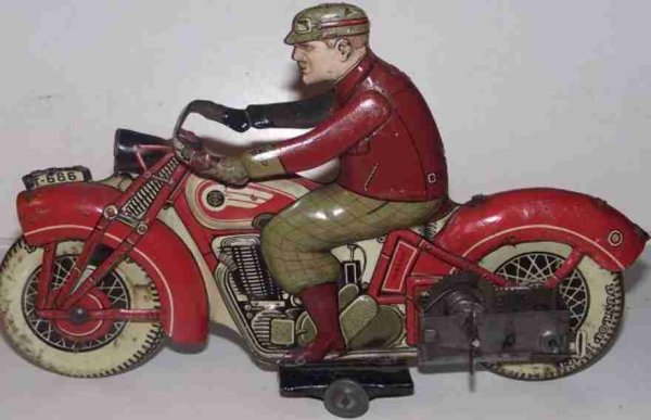 The GIRARD MODEL WORKS Tin-Motorcycles Motorcycel with clockwork in red or blue lithographed with d