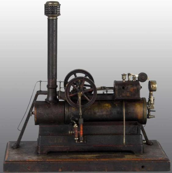Carette Steam Toys-Horizontal Steam Engines Overtype steam engine. It has a steam gauge, weighted sa