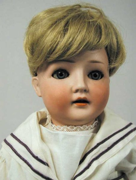 Ohlhaver, Gebrueder Co Dolls Bisque socket head doll, ball jointed composition body. Blue