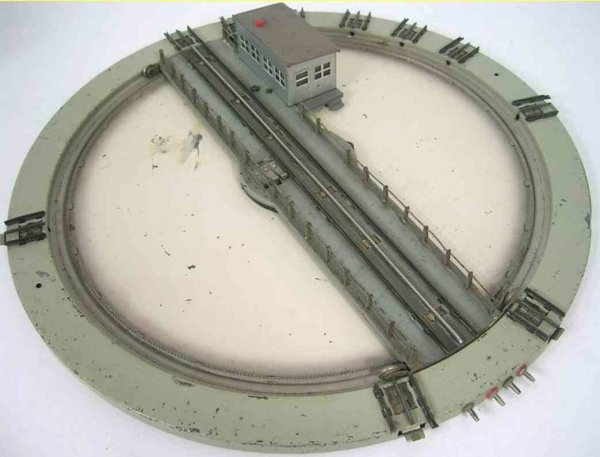 Maerklin Railway-Rails/Power Turntable with 10 sidings, gray building with drive and red
