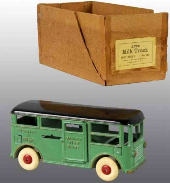 Dent Hardware Co Cast-Iron trucks Milk truck with driver, doors, rubber tires and box