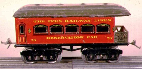 Ives Railway-Passenger Cars Passenger car #73 with eight wheels, red lithographed with r