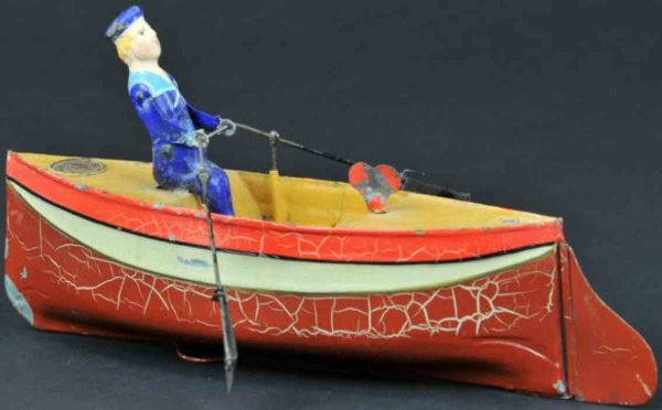 Uebelacker Tin-Ships Rower and rowboat, hand painted overall, rower has oars in h