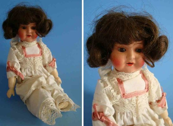 Schönau & Hoffmeister Dolls Porcelain doll head with body made of jointed wood  and slee