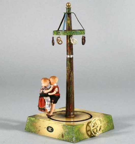 Doll Steam Toys-Drive Models Hand-coated maypole No. 773 with dancing couple of tinplate,