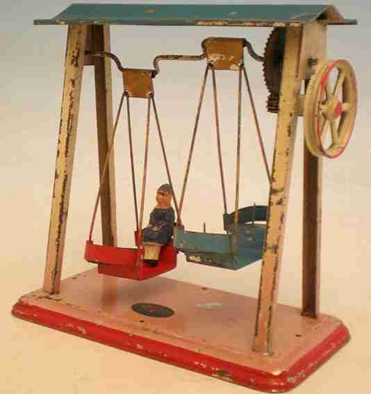 Doll Steam Toys-Drive Models Swing ship No. 784 with three swinging boats each containing