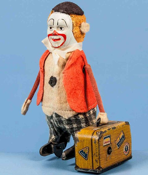 Schuco Tin-Dance Figures Clown with suitcase, plush head and colored felt clothing, k