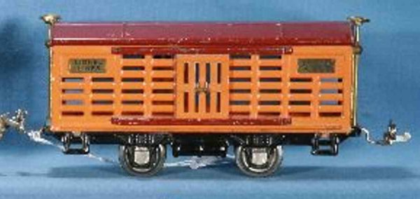 Lionel Railway-Freight Wagons Cattle car with four wheels, with orange body and maroon roo