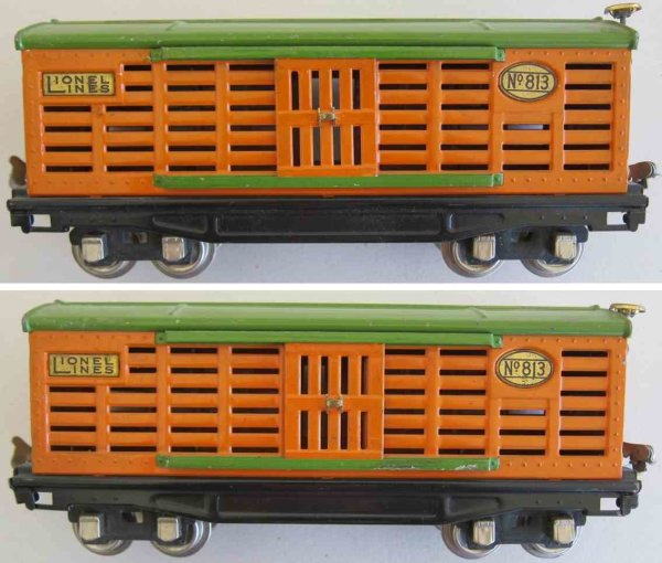 Lionel Railway-Freight Wagons Stock or cattle car with orange body and pea green roof, bra