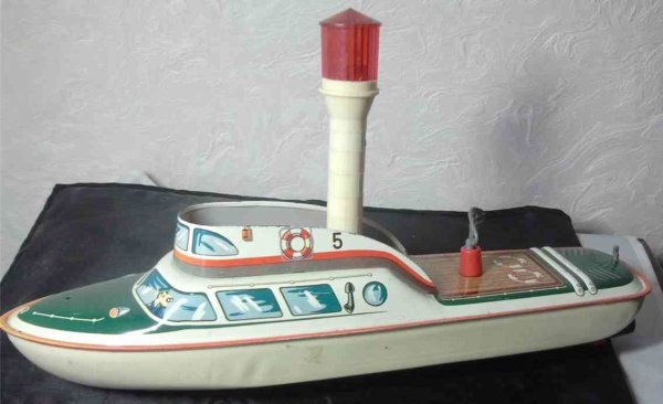 Tippco Tin-Ships Light ship with clockwork and flashing light, the radar is t