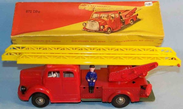 Guenthermann Tin-Fire-Truck Fire ladder car in red, yellow, blue and green, with a firem