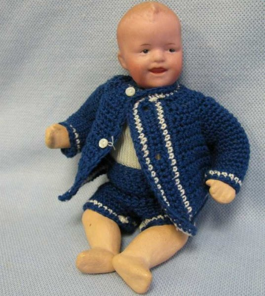 Heubach Gebr. Dolls Laughing character baby on his original bent-limb baby body;