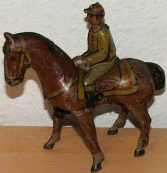 Keim Tin-Figures Horse with jockey #900 and clockwork, marked D.R.P. and D.R.