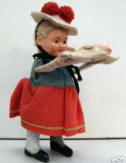 Schuco Tin-Dance Figures  Black forest woman with baby (Baby on first pictures might