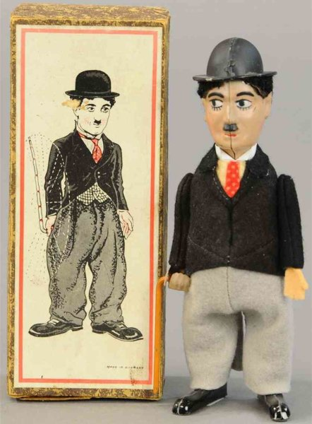 Schuco Tin-Dance Figures Tin windup Charlie Chaplin in short tails figure with cane,