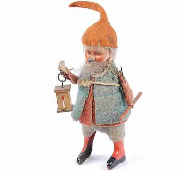 Schuco Tin-Dance Figures Gnome#941 with clockwork, made of tin, felt and wood in  lig