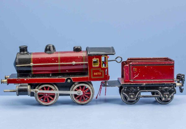 Maerklin Railway-Locomotives Clockwork steam locomotive #9670, old Marklin sign in a red