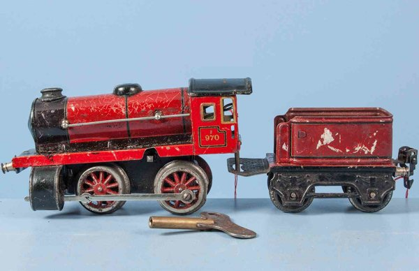 Maerklin Railway-Locomotives Clockwork steam locomotive #970 with four wheels, red and bl
