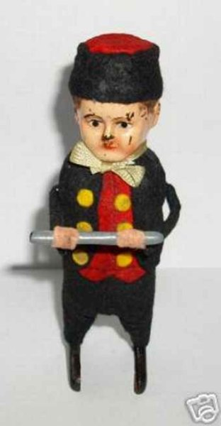 Schuco Tin-Dance Figures Dutch man with flute and clockwork, red waistcoat, black sui