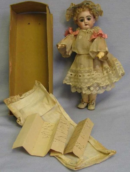 Handwerck Heinrich Dolls Doll in her original box. Box retains its label on the end s