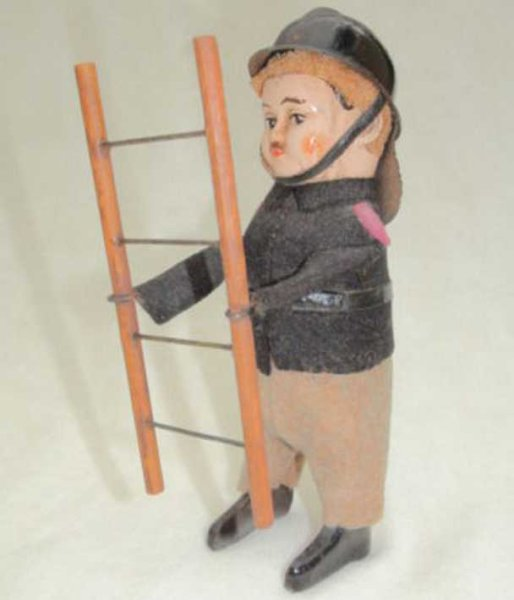 Schuco Tin-Dance Figures Firefighter #997/7 with ladder, helmet and neck protection o