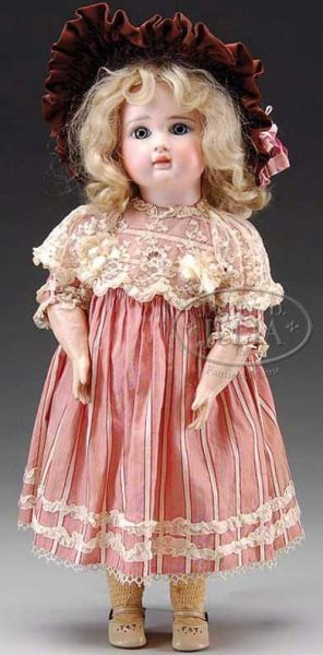 Steiner Jules Nicholas Dolls This French Bebe from a profile view has a large extended up