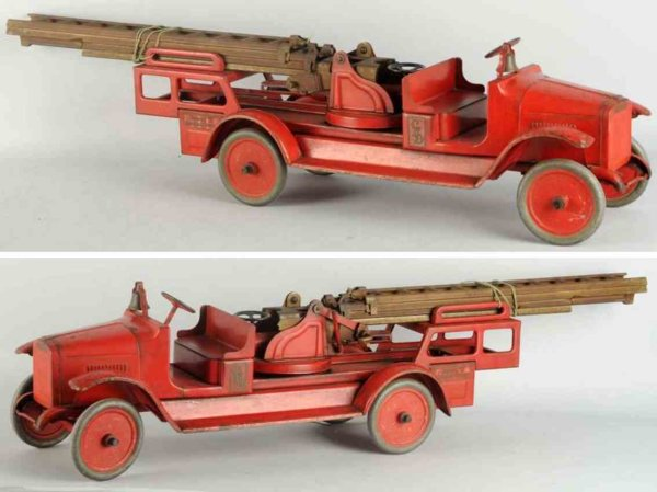 Buddy L Tin-Fire-Truck Pressed steel aerial ladder truck toy in red with original d