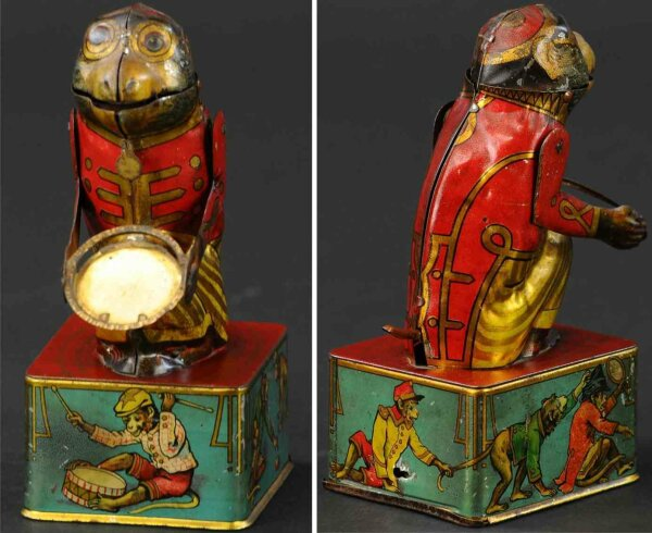 Maienthau & Wolf Tin-Mechanical Banks Monkey with tray bank made of lithographed tin, depicts seat