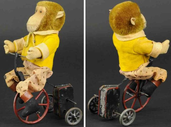 Schuco Tin-Figures Monkey on tricycle, clockwork driven three-wheeler features