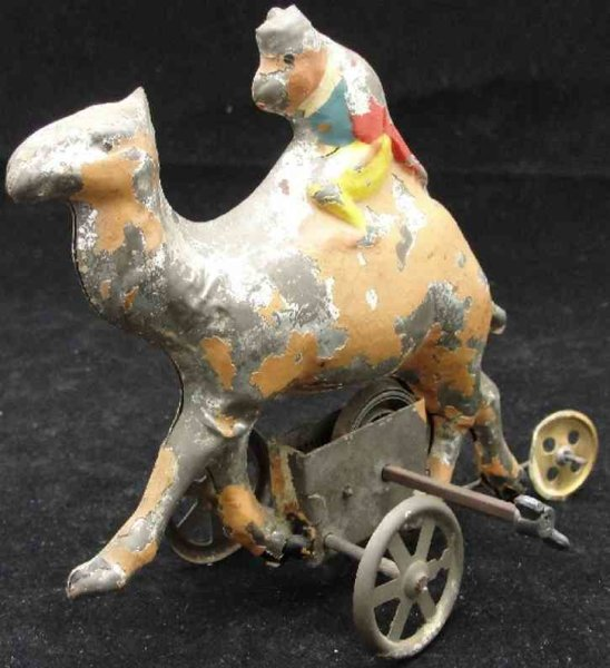 Guenthermann Tin-Figures Monkey riding a ceml wind up toy