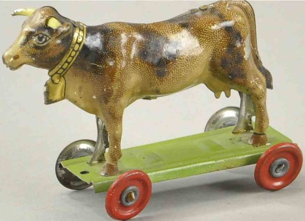 Meier Tin-Penny Toy Cow made of lithographed tin, animal stands on green wheeled