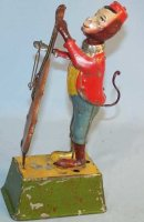 Guenthermann Tin-Figures Wind Up Monkey playing a Bass...
