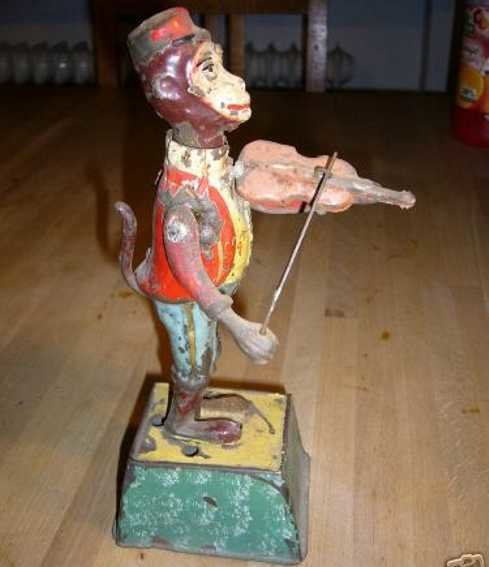 Guenthermann Tin-Figures Monkey with violin and music game clockwork, wound up his he