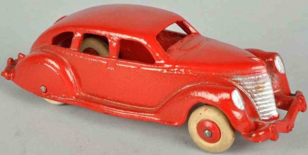 Hubley Cast-Iron Oldtimer Cast iron airflow automobile in red with white rubber tires