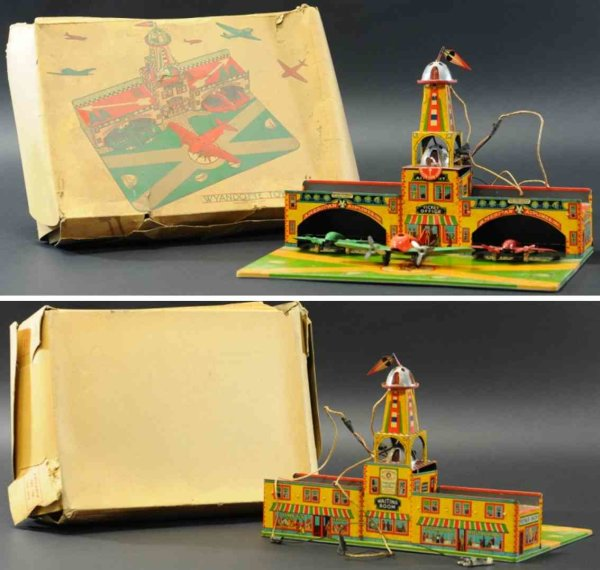 Wyandotte Tin-Toys Tin lithographed city airport with two hangars and runway sq